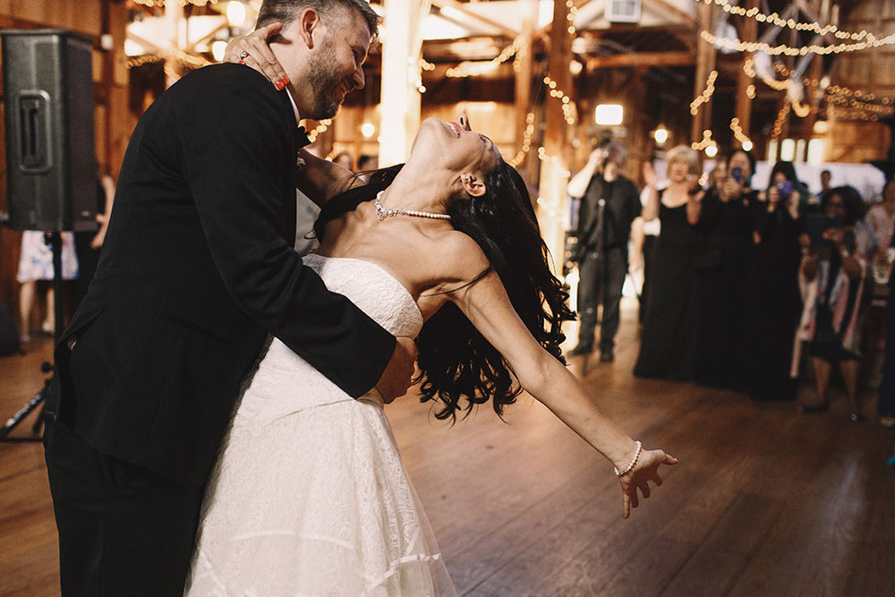 Couple dances at their wedding after determining what percentage of guests would attend their wedding day