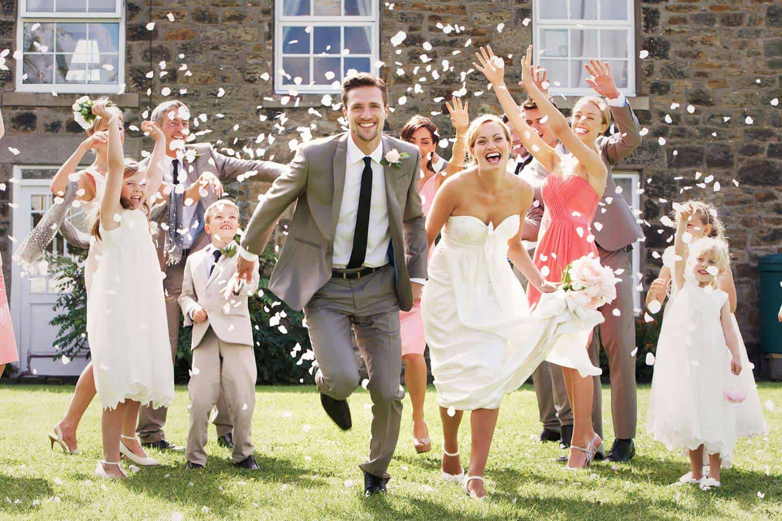 Bride and groom celebrates with their guests after receiving all of their RSVPs on time