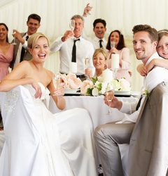 Guests sitting at a table at a wedding